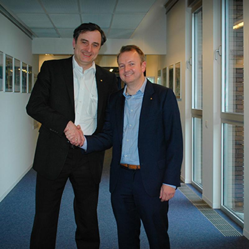 Matthias Bopp (CEO TDK-Micronas) and Bram De Muer (CEO ICsense) shake hands on the transaction