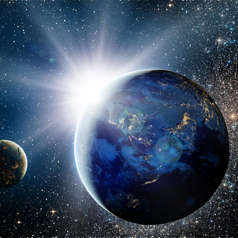Planet and satellites in space